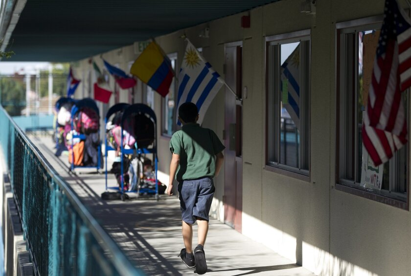 Flags from countries around the world adorn the classrooms at the Chula Vista Learning Community charter school in Chula Vista. | Photo by Earnie Grafton/The San Diego Union-Tribune.