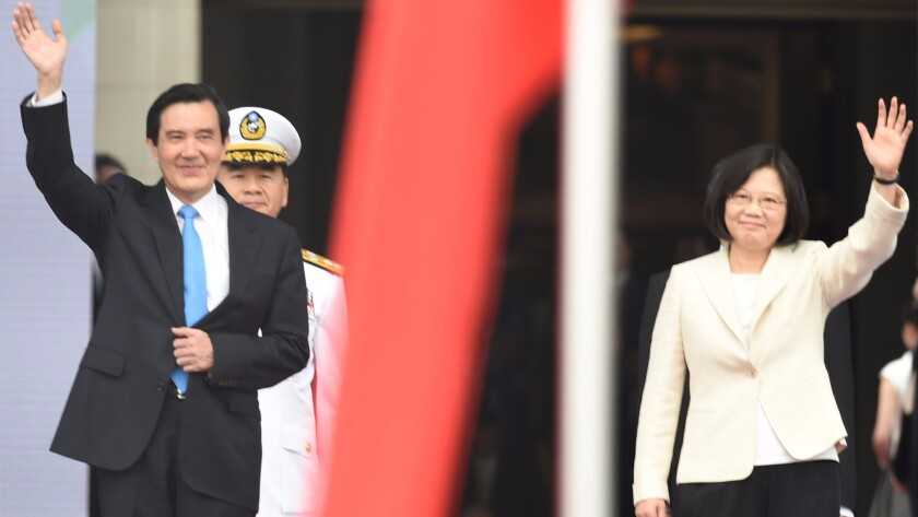 Outgoing Taiwanese President Ma Ying-jeou, left, and President-elect Tsai Ing-wen wave as they prepare for Tsai's presidential inauguration in Taipei on May 20, 2016.