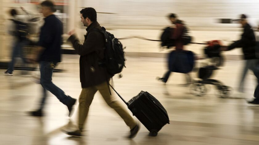 Travelers move through 30th Street Station ahead of the Thanksgiving holiday in Philadelphia, Tuesda