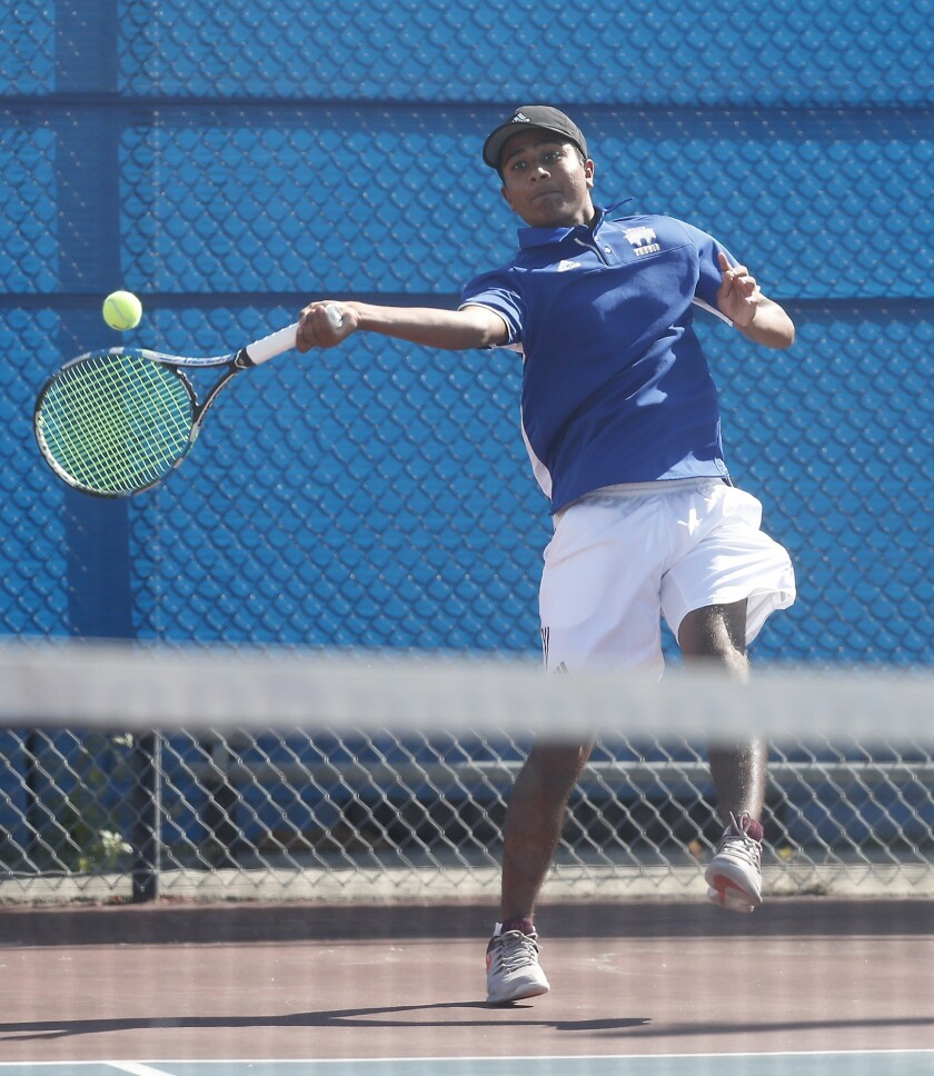 Fountain Valley High No. 1 doubles player Vivek Savsani hits against Corona del Mar during a Surf Le