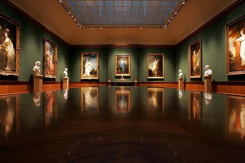 A wide view of the Thornton Portrait Gallery at the Huntington, lined with paintings