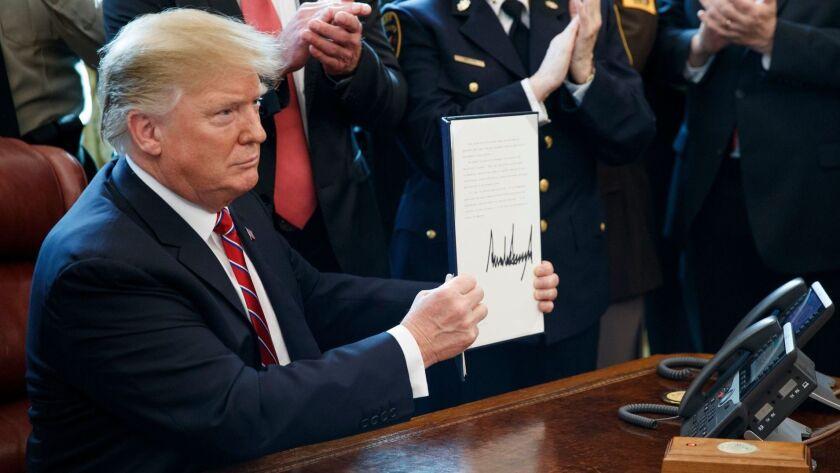 US President Donald J. Trump signs veto of legislation to strike down his national emergency declaration at the southern border, Washington, USA - 15 Mar 2019