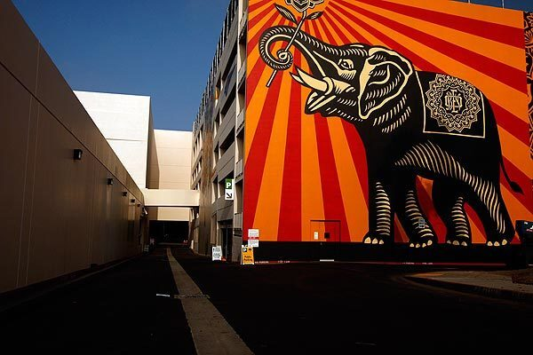 """A mural by artist Shepard Fairey titled """"Peace Elephant"""" graces the west wall of a parking structure at the new West Hollywood Library. See full story"""