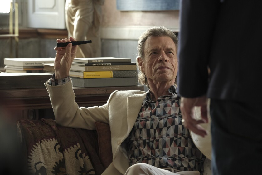 """Mick Jagger as Joseph Cassidy in a scene from """"The Burnt Orange Heresy."""""""