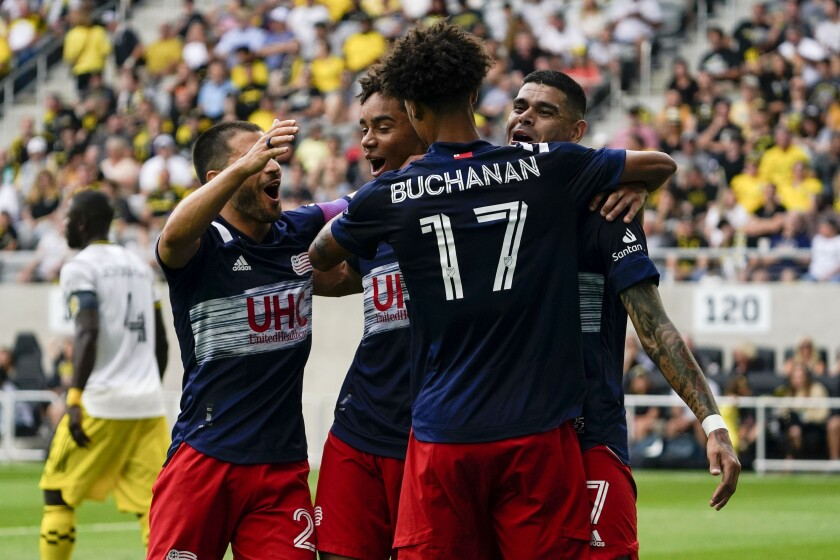 New England Revolution forward Gustavo Bou (7) celebrates with teammates after scoring a goal in the first half of an MLS soccer match against the Columbus Crew in Columbus, Ohio on Saturday, July 3, 2021. (AP Photo/Jeff Dean)