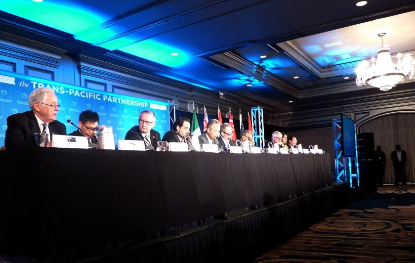 Delegates attending the Trans-Pacific Partnership talks hold a press conference Oct. 5 in Atlanta. Twelve Pacific rim countries sealed the deal then to create the world's largest free trade area.
