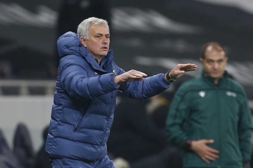 Tottenham's manager Jose Mourinho throws the ball to one of his players during a Group J Europa League soccer match and between Tottenham Hotspur and Ludogorets at the Tottenham Hotspur stadium in London, England, Thursday Nov. 26, 2020. (Ian Kington/Pool via AP)
