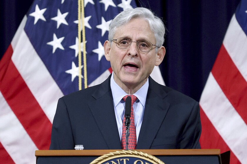 FILE - In this June 15, 2021, file photo, Attorney General Merrick Garland speaks at the Justice Department in Washington. In his first wide-ranging question-and-answer session with reporters, Garland talked about the death penalty, the department's defense of former President Donald Trump against a defamation suit and the protection of journalists and their sources.(Win McNamee/Pool via AP)