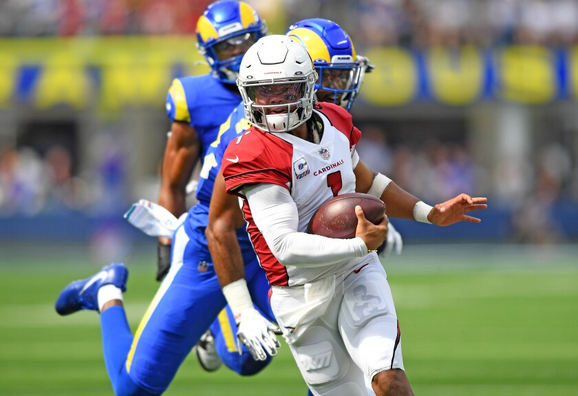 Cardinals quarterback Kyler Murray scrambles for a first down against the Rams.