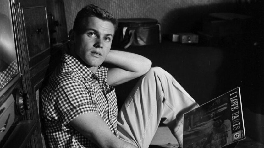 Actor Tab Hunter poses at home in Los Angeles in 1955.