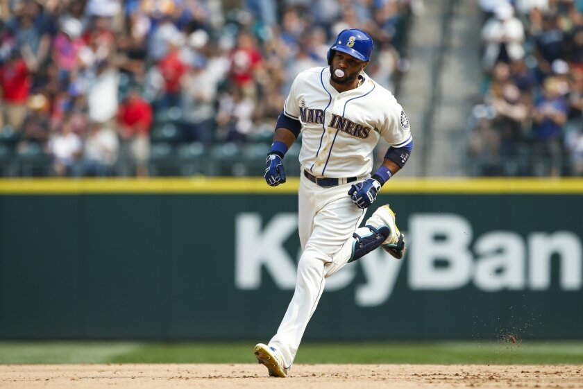 Seattle Mariners' Robinson Cano runs the bases after hitting a two-run home run against the Chicago White Sox during the fifth inning of a baseball game, Sunday, Aug. 23, 2015, in Seattle. (AP Photo/Joe Nicholson)
