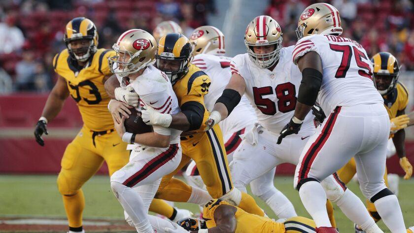 SANTA CLARA, CA - OCTOBER 21, 2018: Los Angeles Rams defensive tackle Aaron Donald (99) sacks San F