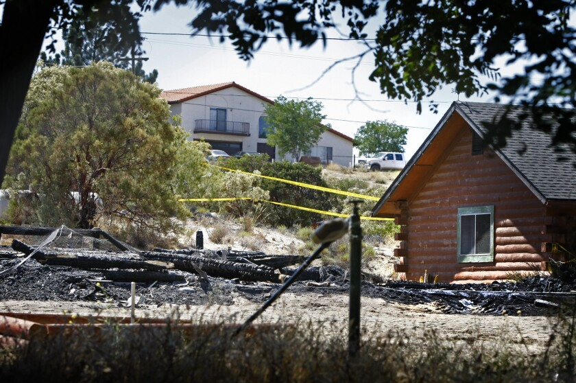 The burned ruins of a house on Ross Avenue in Boulevard, Calif., where the bodies of a mother and a boy were found by arson investigators. James Lee DiMaggio, 40, who lived there, and the deceased mother's daughter, Hannah Anderson, 16, are missing.