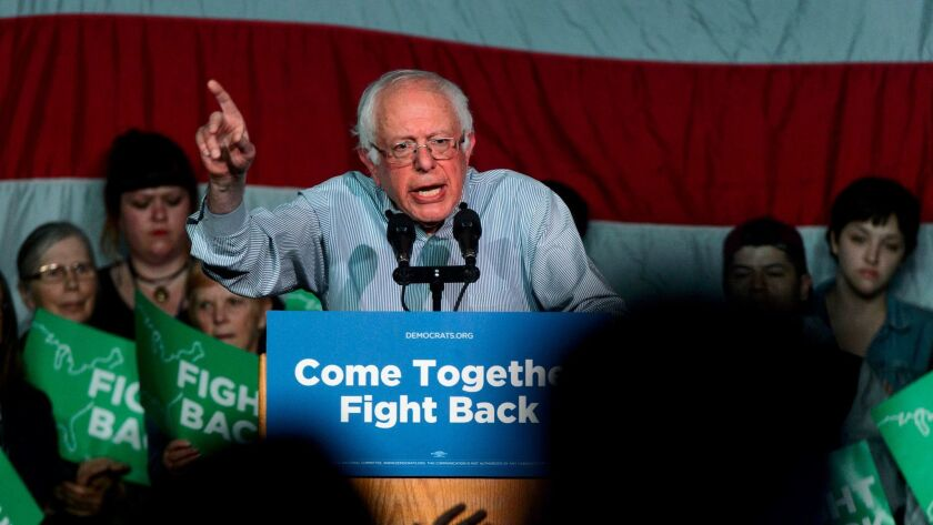 Former Democratic presidential candidate Sen. Bernie Sanders urges Americans to work together as he