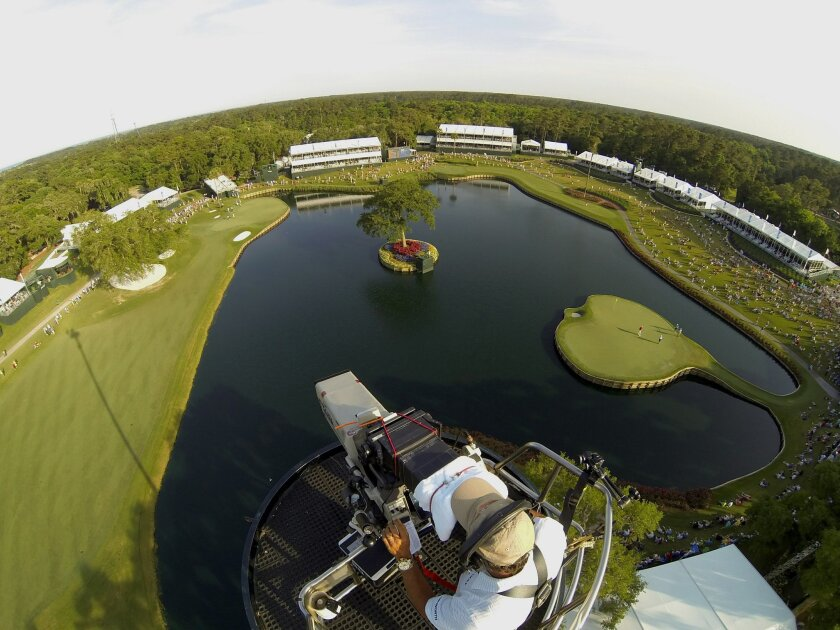 """NBC cameraman John """"Bo"""" Boeddeker works at one of his favorite venues -- 120 feet above the 17th green in the Players Championship."""