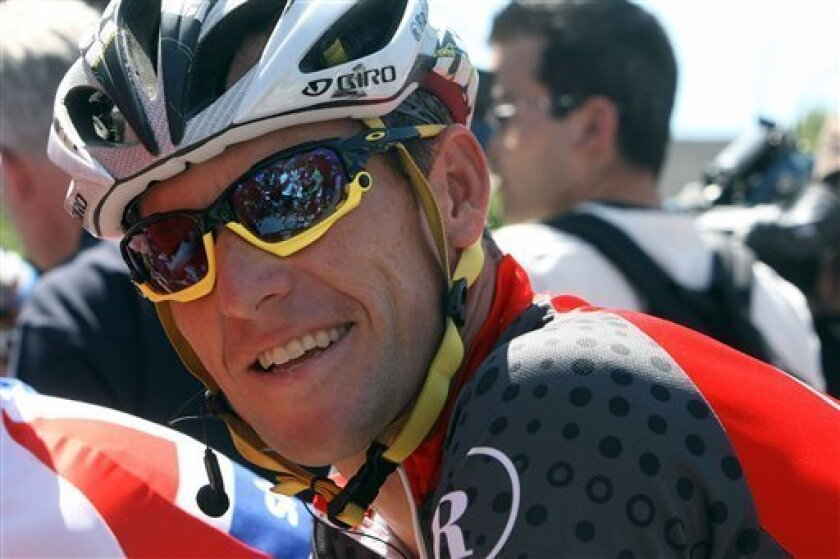 U.S. Lance Armstrong of the Radioshack team smiles at the start of the first race of the Tour de Luxembourg in Luxembourg, Thursday June 3, 2010. (AP Photo/Geert Vanden Wijngaert)