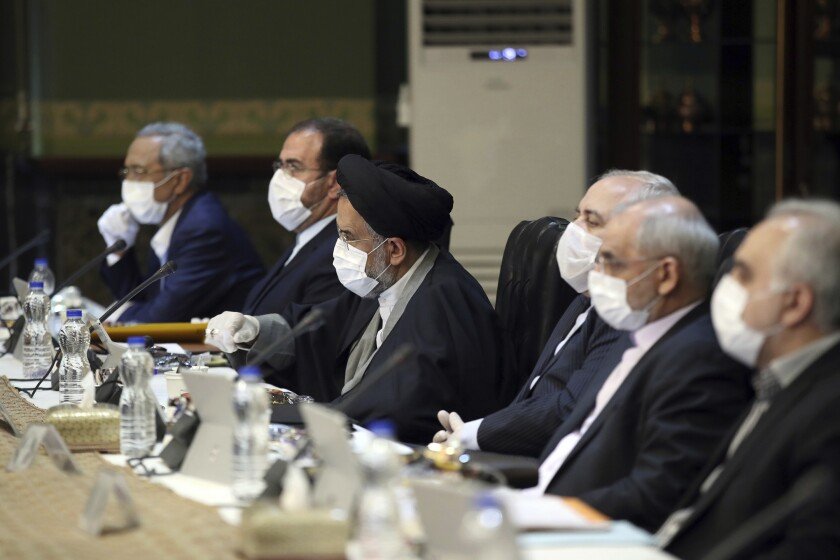 Iranian Cabinet members wearing face masks and gloves meet in Tehran.