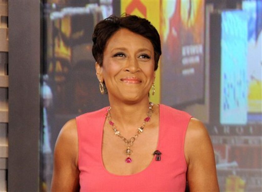 "FILE - This Aug. 20, 2012 file photo released by ABC shows co-host Robin Roberts during a broadcast of ""Good Morning America,"" in New York. Roberts' grueling road to recovery will be bringing her back to the ""Good Morning America"" anchor desk soon. Appearing from her home on Monday's show, Jan. 14, 2013, Roberts wore a broad smile as she announced that her most recent bone marrow test showed ""no abnormalities"" _ no sign of the life-threatening disease that has kept her off the air for months. (AP Photo/ABC, Donna Svennevik, File)"