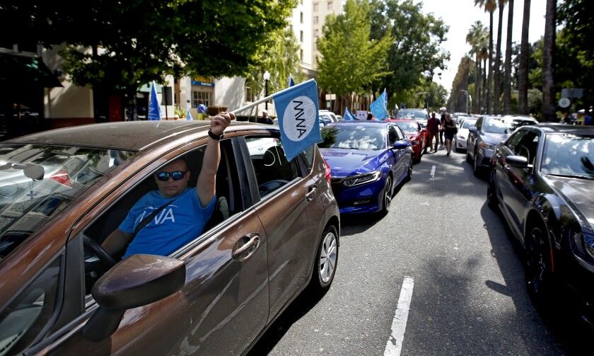 Drivers for Uber and Lyft and their supporters rallied in Sacramento this week for a bill that would limit the ability of companies to label workers as independent contractors.