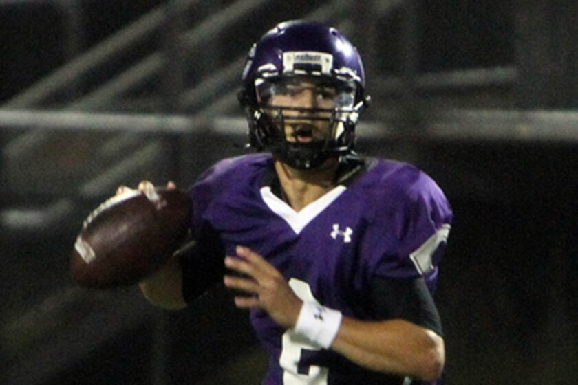 Carlsbad quarterback Christian Chapman threw three touchdown passes in the season opener.