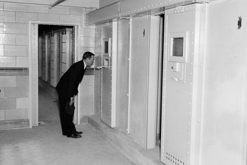 FILE - In this May 23, 1935 file photo, solitary confinement cells are shown at Rikers Island prison in New York. New York City officials have unveiled reforms they claim add up to a groundbreaking ban on solitary confinement on Rikers Island. (AP Photo/John Rooney, File)