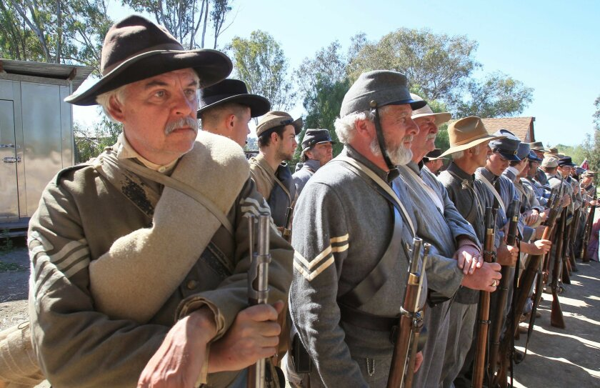 Confederate Army troops stand, ready to march into battle against the Union Army in a Civil War battle reenactment at The Antique Gas & Steam Engine Museum in Vista.
