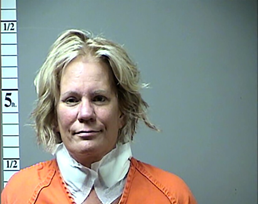 FILE - In this 2016 file booking photo, provided by the St. Charles County, Mo., Prosecuting Attorney's Office shows Pamela Hupp. The Major Case Squad of Greater St. Louis has agreed to reopen the investigation of the 2011 murder of Betsy Faria in Lincoln County, Mo. The decision comes two months after Faria's friend, Hupp, was sentenced to life in prison without parole for another murder. Faria's husband was initially convicted in her death but later acquitted in retrial. (St. Charles County, Missouri, Prosecuting Attorney's Office via AP, File)