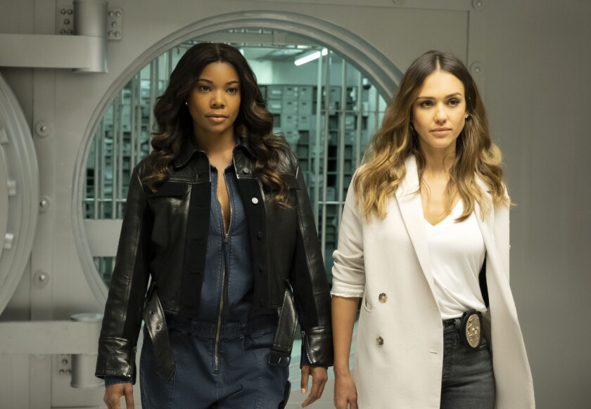 """This image released by FOX hows Gabrielle Union, left, and Jessica Alba in a scene from """"L.A.'s Finest."""" The series will premiere in the fall. (Erica Parise/FOX via AP)"""