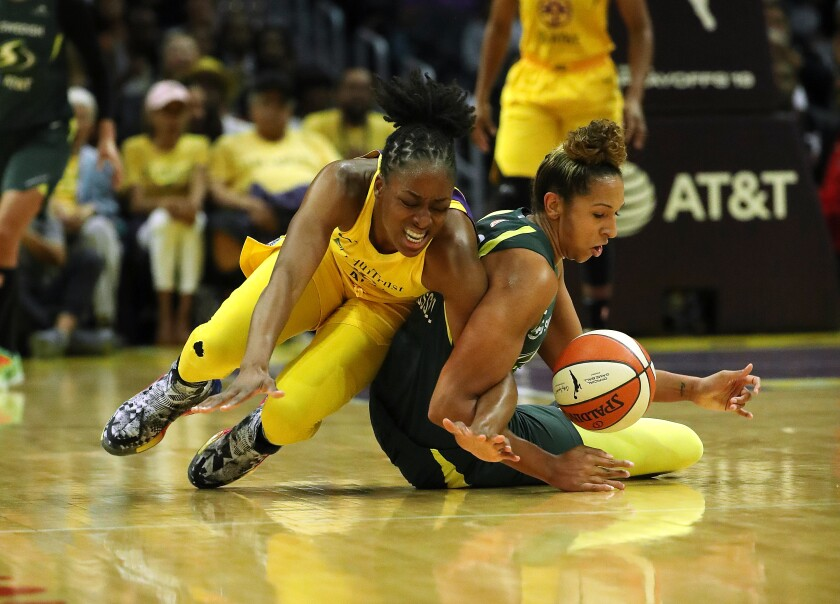 Sparks forward Nneka Ogwumike, left, and Seattle Storm forward Mercedes Russell battle for a loose ball.