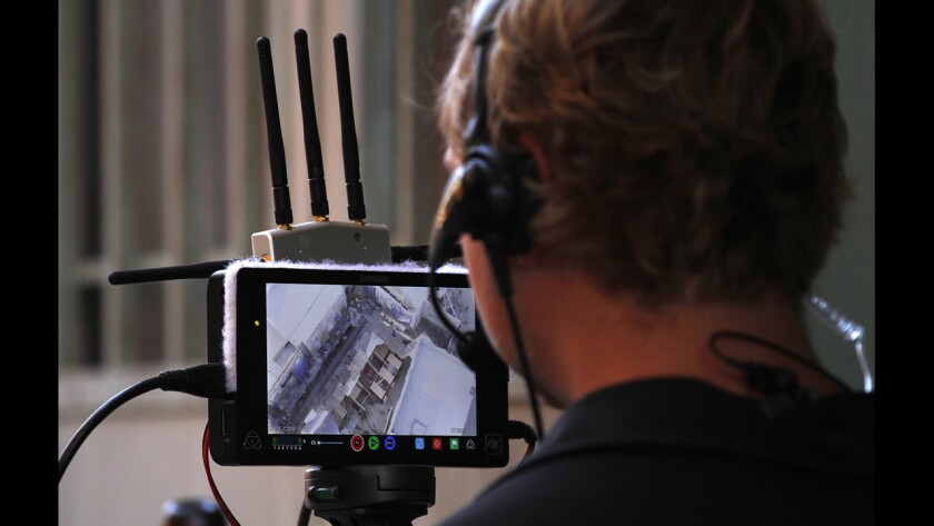 """Austin Harris, a camera operator for Aerial MOB, watches a monitor during shooting of a scene for """"Criminal Minds: Beyond Borders"""" in Santa Clarita."""