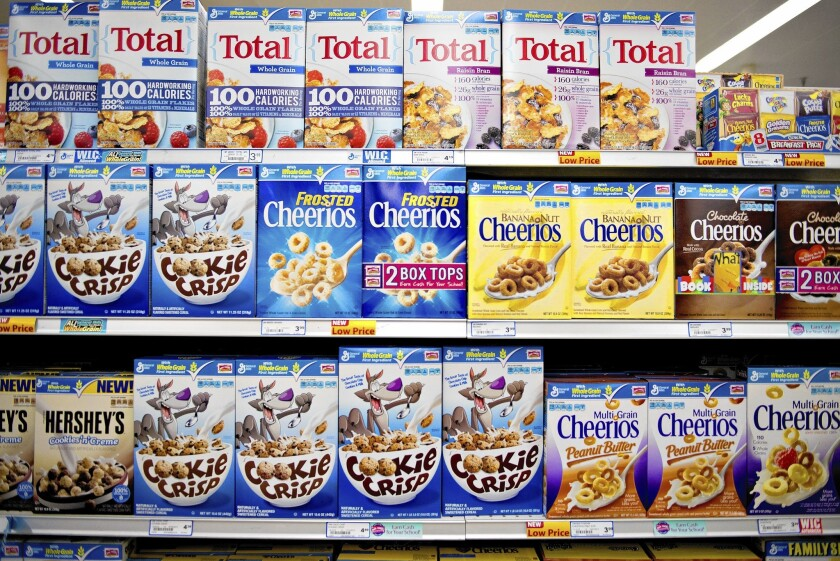 General Mills Inc. cereal sits on display. The company is among the world's 10 largest food and drink firms, which Oxfam is prodding to reduce greenhouse gas emissions as part of its Behind the Brands campaign that scores the companies in social and environmental responsibility.