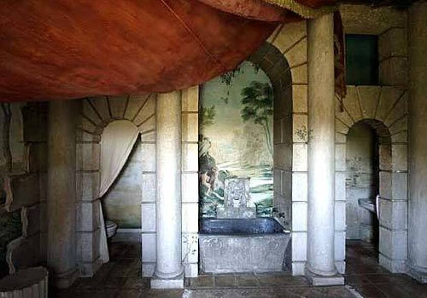 Val Verde features a flamboyant master bathroom with Roman-style murals from 1939.