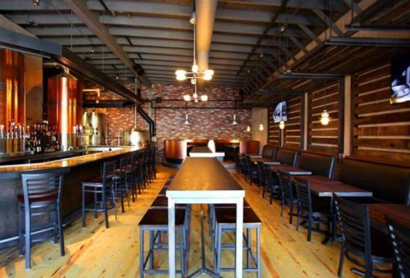 The interior of La Jolla Brewing Company features a spacious 6,000-square foot wood/iron décor. Courtesy
