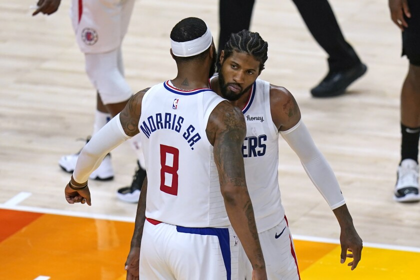 Los Angeles Clippers' Marcus Morris Sr. (8) and Paul George
