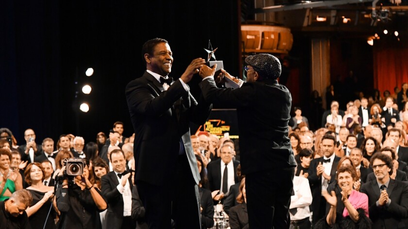 Spike Lee, right, presents the AFI Life Achievement Award to Denzel Washington at the Dolby Theatre on Thursday.