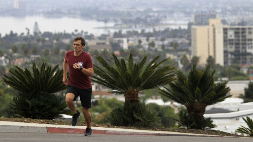 Grant LeBeau running in a neighborhood near his La Jolla residence before work,11/08/18, with a view