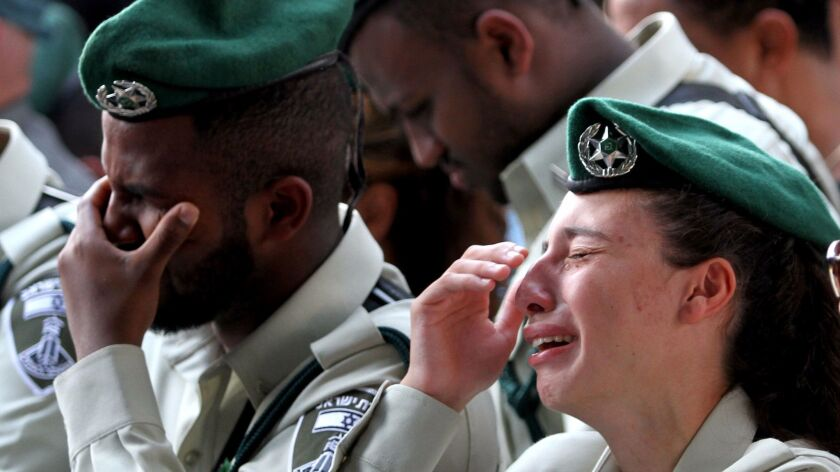 Israeli security forces mourn during the funeral of border police officer Solomon Gabariya, one of three Israeli guards killed in a shooting attack in the West Bank. The funeral was in Beer Yaakov, near Tel Aviv, on Sept. 26, 2017.
