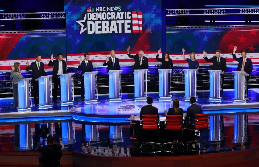 All candidates in the second debate raise their hands when asked if they would provide healthcare for undocumented immigrants, during the Democratic primary <b>debate</b> hosted by NBC News at the Adrienne Arsht Center for the Performing Arts in Miami.