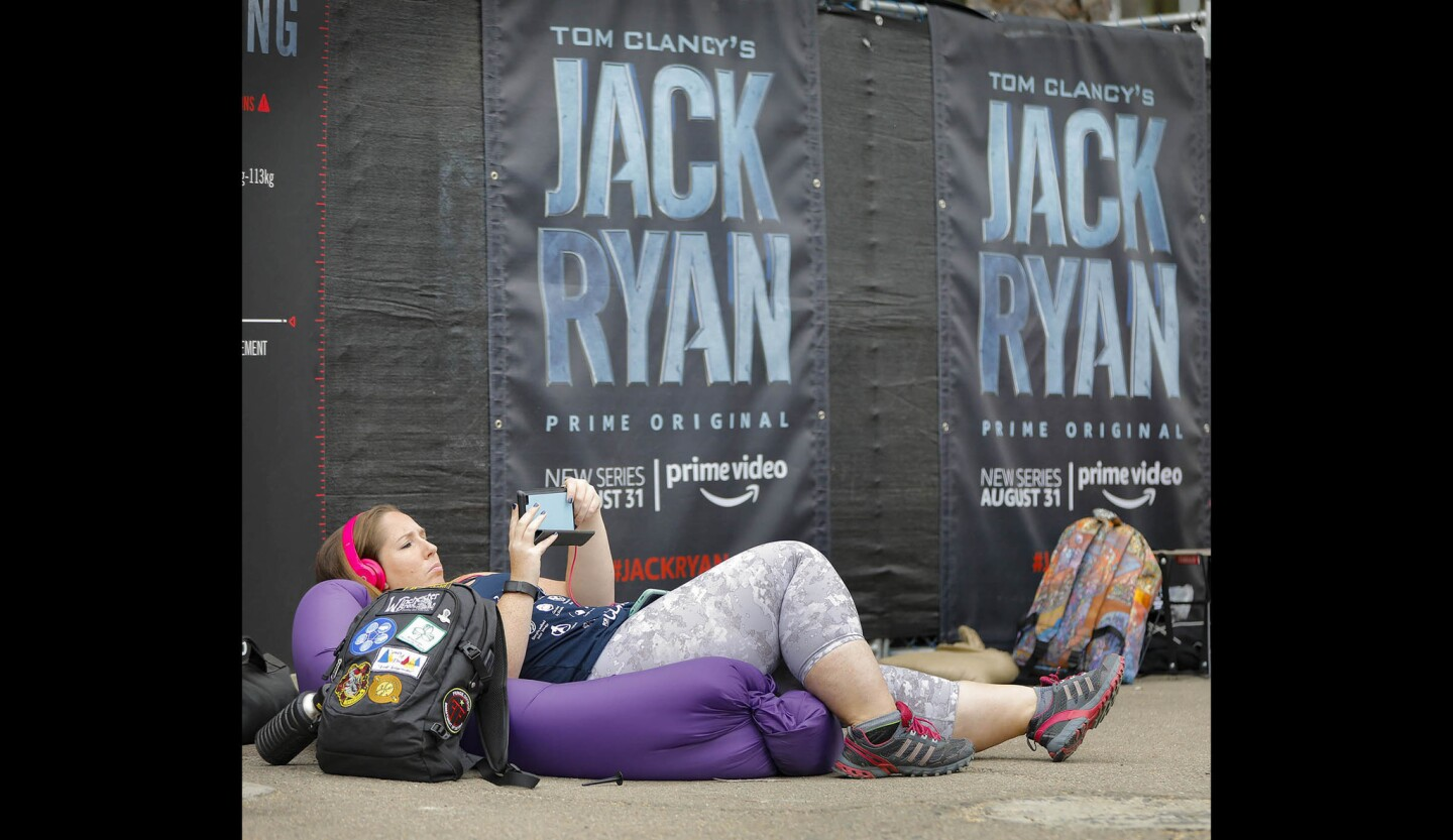Comic-Con fan Sarah Ludy from Massachusetts waits in line outside the Jack Ryan Experience across the street from the San Diego Convention Center.