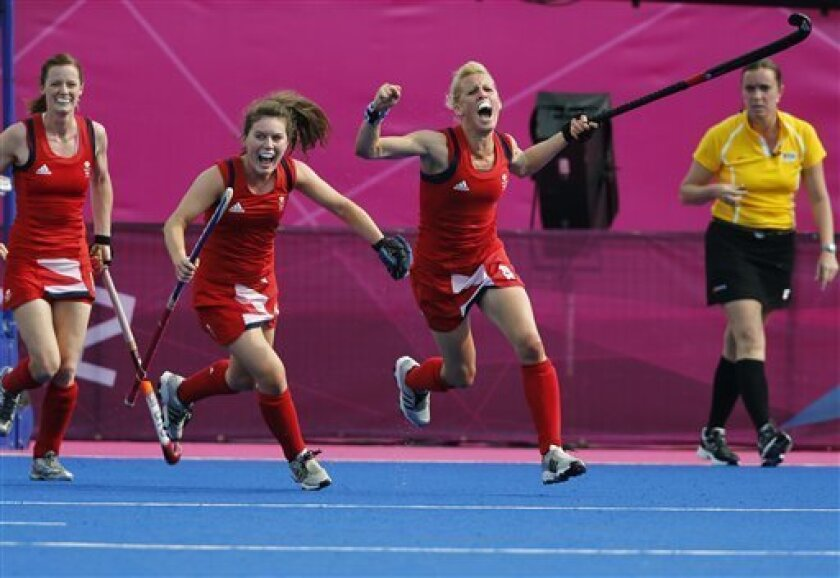Britain's Alex Danson, right, celebrates after scoring a goal against New Zealand during the women's field hockey bronze medal match at the 2012 Summer Olympics, Friday, Aug. 10, 2012, in London. (AP Photo/Eranga Jayawardena)