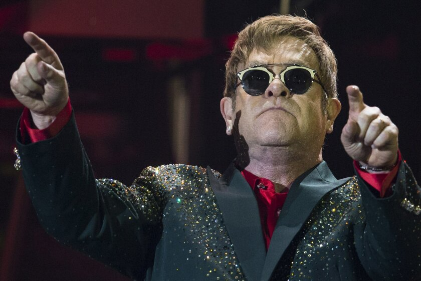 Musician Elton John performs at his concert in the Crocus City Hall outside Moscow, Russia, Monday, May 30, 2016. (AP Photo/Pavel Golovkin)
