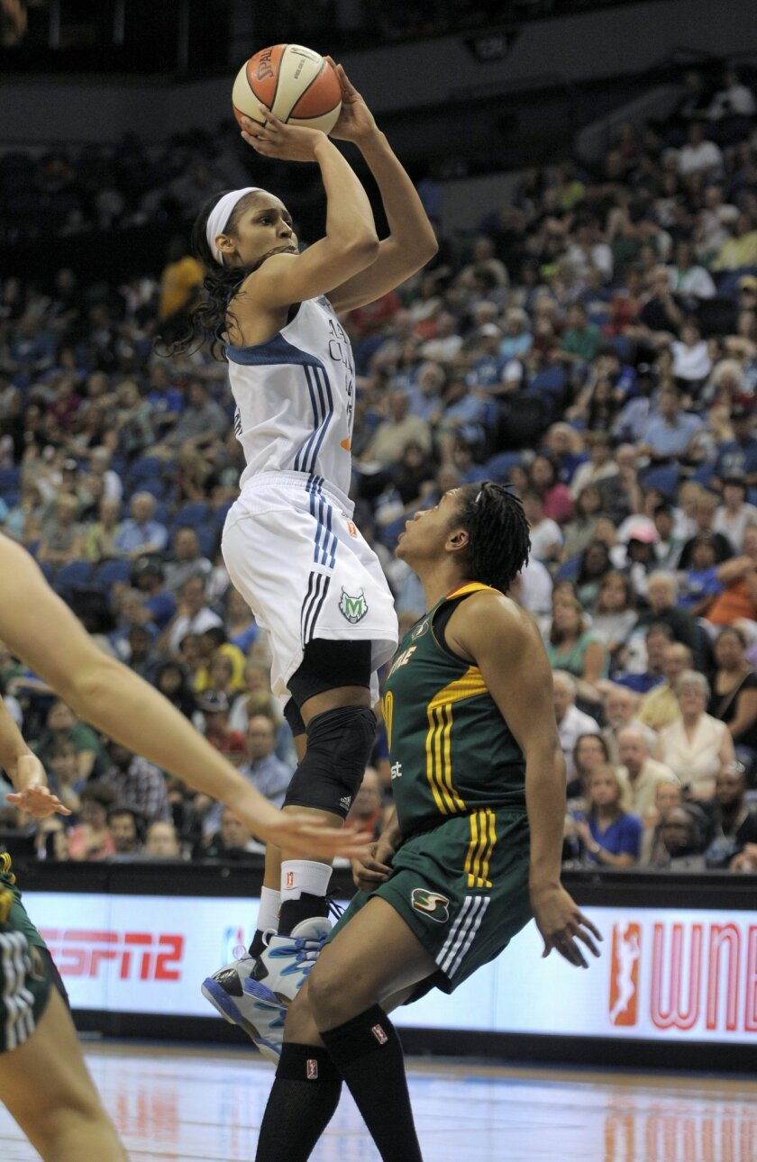 Minnesota Lynx forward Maya Moore shoots over Seattle Storm guard Tanisha Wright during the third quarter of a WNBA basketball game Sunday, July 13, 2014, in Minneapolis. Moore had a game-high 26 points. Minnesota won 77-60. (AP Photo/Tom Olmscheid)