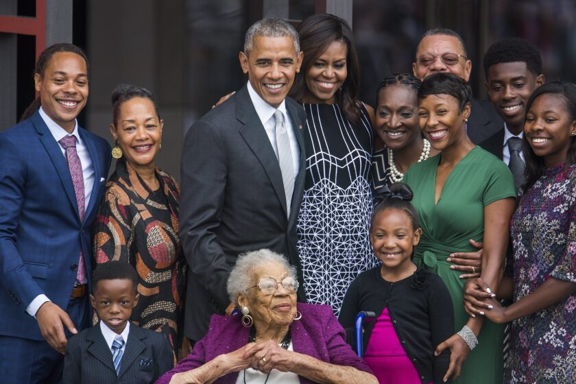 President Obama and First Lady Michelle Obama pose with four generations of the Bonner family, who are descendants of slaves, after ringing the First Baptist Church Bell to officially open the Smithsonian's National Museum of African American History and Culture in Washington, D.C.