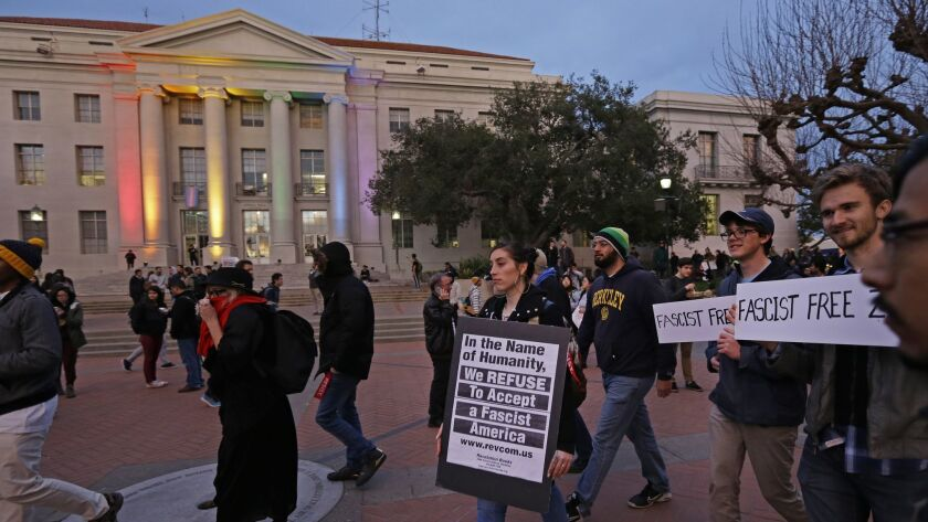 People march in front of Sproul Plaza on the UC Berkeley campus to protest the appearance of far-right activist Milo Yiannopoulos in 2017.