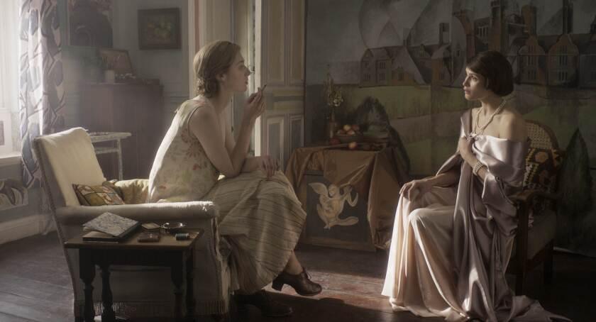 "Elizabeth Debicki, left, as Virginia Woolf and Gemma Arterton as Vita Sackville-West in ""Vita & Virginia."""