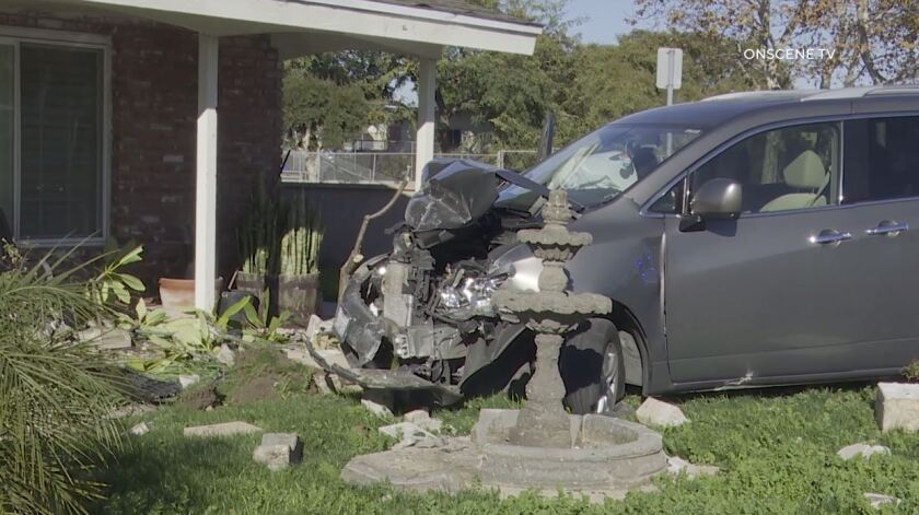 A woman crashed a van into a Chula Vista home Monday afternoon while she and her boyfriend were allegedly being chased by another man, police said.