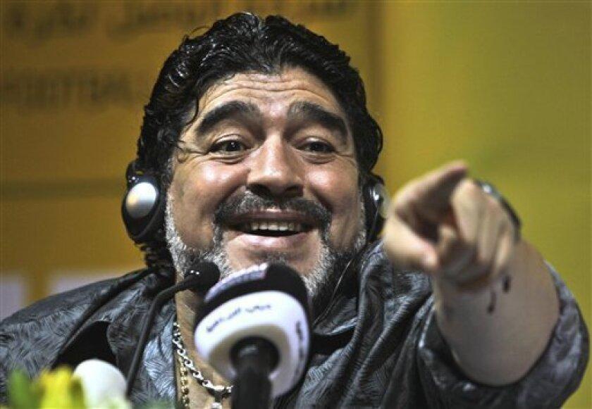 Al Wasl coach Argentine Diego Maradona reacts during a press conference in Dubai, United Arab Emirates, Sunday Sept. 11, 2011. (AP Photo/Kamran Jebreili)