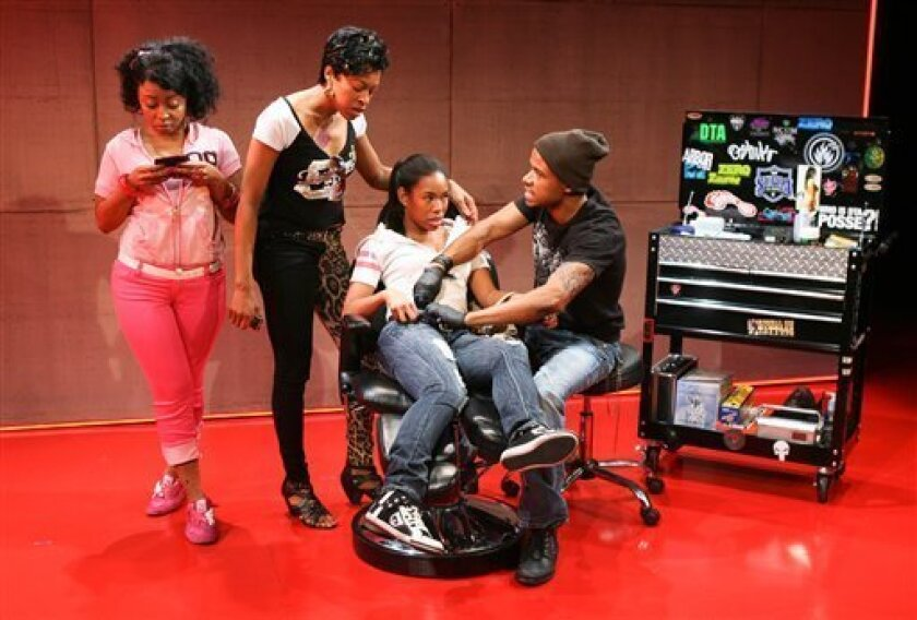 "In this theater image released by The Publicity Office, from left, Nikiya Mathis, Cherise Booth, Angela Lewis and LeRoy McClain are shown in a scene from Kirsten Greenidge's play, ""Milk Like Sugar"" performing off-Broadway at Playwrights Horizons. (AP Photo/The Publicity Office; Ari Mintz)"