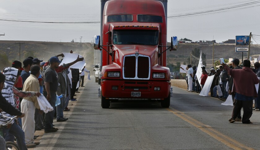 Striking farmworkers yell at a northbound produce truck last week in Colonet, in the Mexican state of Baja California.