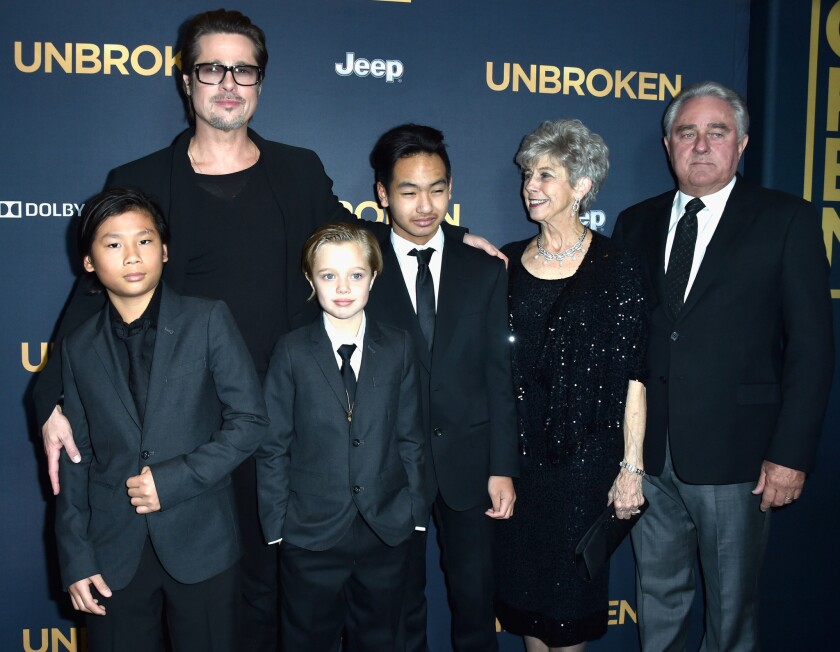 """Unbroken"" director Angelina Jolie's husband Brad Pitt, kids Pax, Shiloh and Maddox and Pitt's parents, Jane and William Pitt, attend the Hollywood premiere of the film while Jolie deals with chicken pox."
